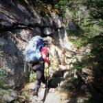 Jess climbing stone steps on a hiking trail